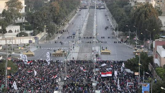 Egyptian protesters gather near the presidential palace in Cairo