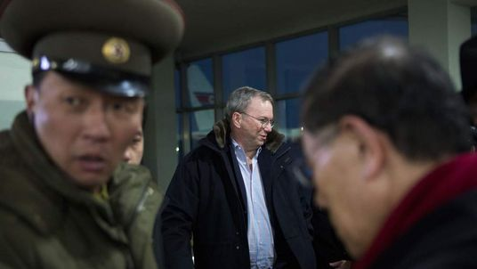 Executive Chairman of Google Eric Schmidt, center, arrives at Pyongyang International Airport in Pyongyang, North Korea