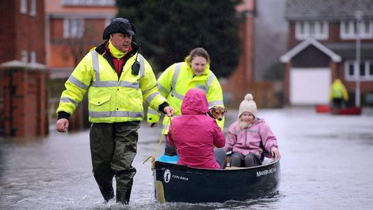 People are evacuated from flooded streets in the Thames Valley