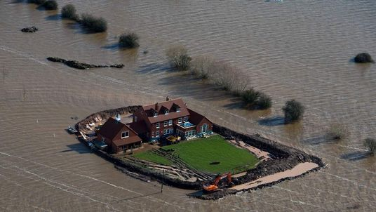 Storms hit UK with more rain, flooding and even snow