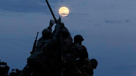 The super moon rises over the Iwo Jima memorial in Arlington