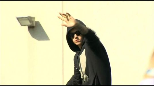 Justin Bieber waves to fans on being released on bail
