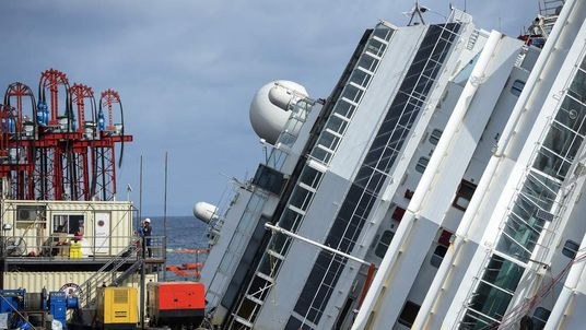 members of the US salvage company Titan and Italian firm Micoperi work at the wreck of Italy's Costa Concordia