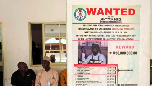 A poster advertising for the search of Boko Haram leader Abubakar Shekau is pasted on a wall in Baga