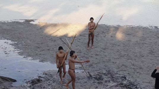 Members of a previously uncontacted tribe make contact with a team of researchers near the Envira river