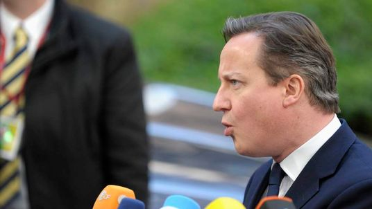 Britain's Prime Minister Cameron arrives at a European leaders emergency summit on the situation in Ukraine, in Brussels