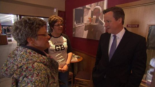 David Cameron speaks to Gary Barlow fans