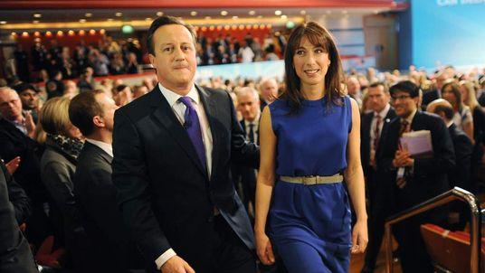 David and Samantha Cameron leaving the hall