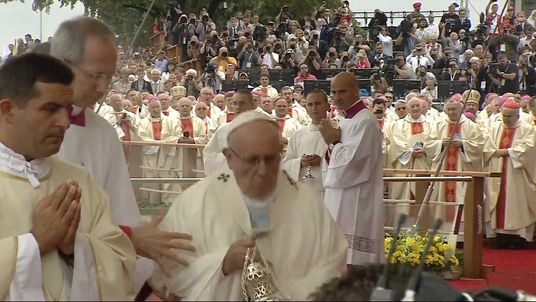 The Pope stumbles during an open air mass in Poland