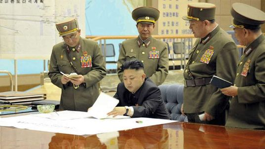 A picture released by the North Korean Central News Agency (KCNA) shows Kim Jong-Un holding a meeting.