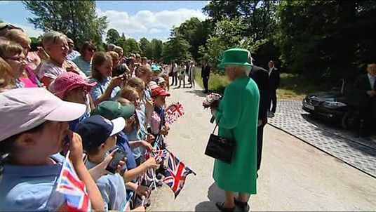 Queen is greeted by a group of schoolchildren at Lake Windermere