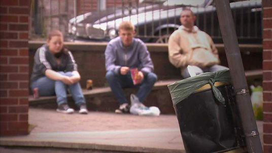 Unemployed young people outside a jobcentre in Rochdale