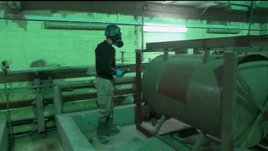 Inspectors at a Syria chemical weapons facility