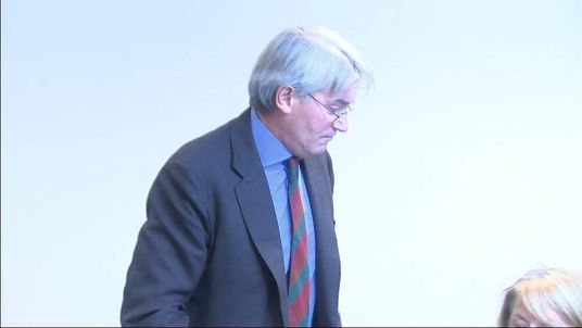 Andrew Mitchell leaves his news conference