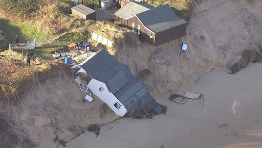 Homes slipped on to the beach at Hemsby, Norfolk