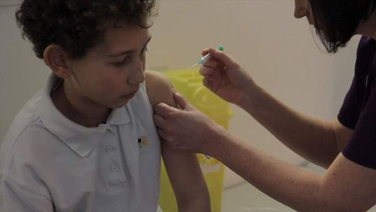 Boy receiving an injection