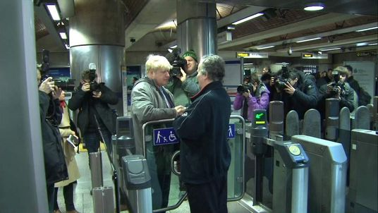London Mayor Boris Johnson with non-striking tube worker