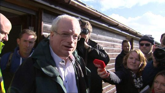Lord Smith, the head of the Environment Agency, talks to waiting reporter