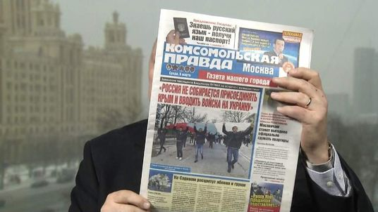 Ian Woods with Russian newspaper