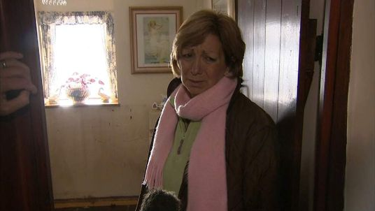 Maria Maye surveys the damage at her home in Fordgate, Somerset.