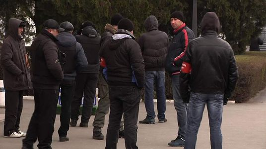 Pro-Russian militants take control of the main airport in Crimea