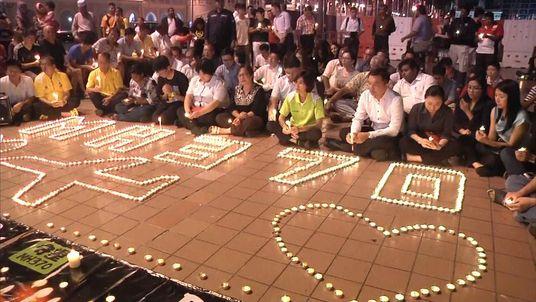 Families of passengers missing on flight MH370 hold a prayer vigil in Kuala Lumpur.