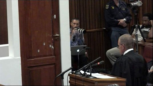 Pistorius describes opening the bathroom door to get to Reeva