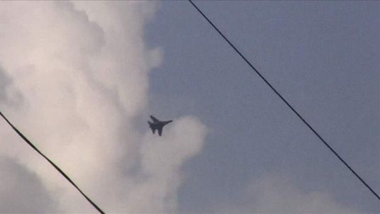 A Ukrainian jet seen flying over the eastern city of Kramatorsk on Tuesday April 15, 2014.