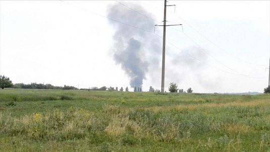 Smoke rising from military helicopter shot down by Ukraine rebels