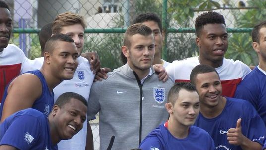 The England football team visit one of Rio's infamous favelas
