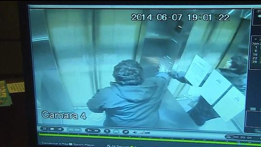 Jose Vergara frantically presses buttons as the elevator races to the roof