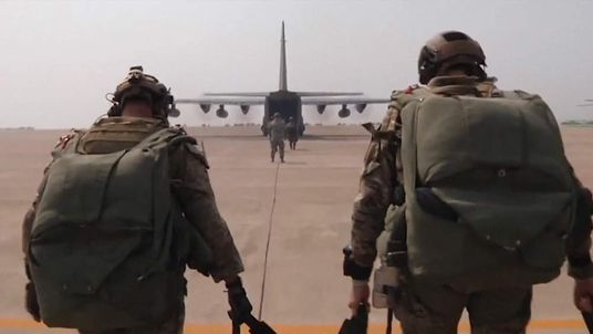US Troops Walking Toward Military Aircraft