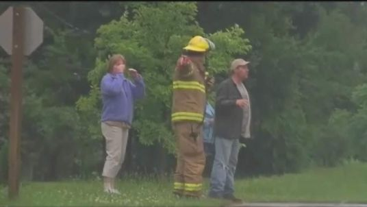 Rescue teams search for a teenager who was swept into an Iowa storm drain