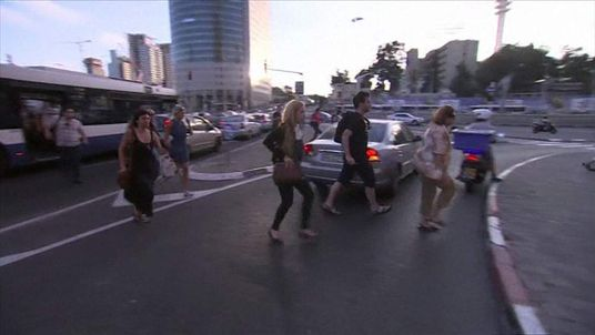 People running in the streets of Tel Aviv
