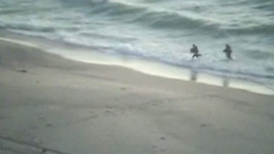 Suspected Palestinian militants coming out of sea at Zikim, Israel