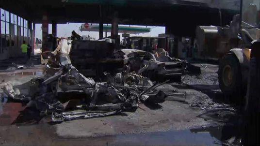 Shell of car after rocket hits petrol station in Ashdod, Israel