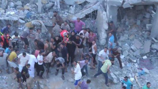 Palestinians run for cover during Israeli airstrike in Rafah, Gaza