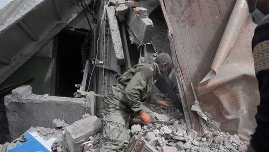 A destroyed apartment block in Snizhne, eastern Ukraine