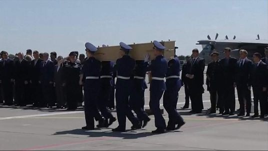 MH17 plane Victims' coffins loaded onto plane at Kharkiv, Ukraine