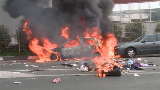 Burnt-out cars in Paris following pro-Palestinian protests