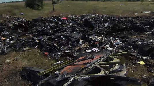 Charred debris from flight MH17
