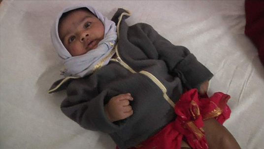 baby rescued from under India mudslide