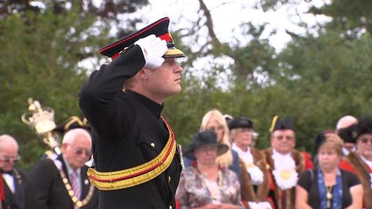Prince Harry saluting during the last post
