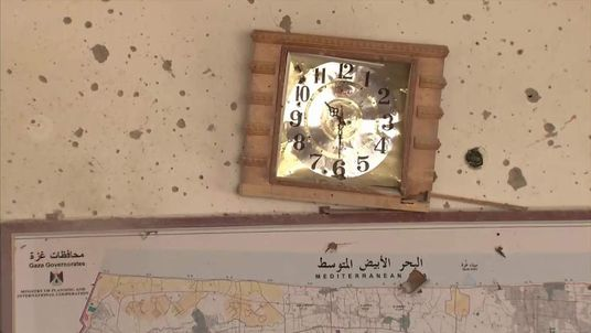 A clock in the Rafah mayor's office stopped at the time the first rocket hit