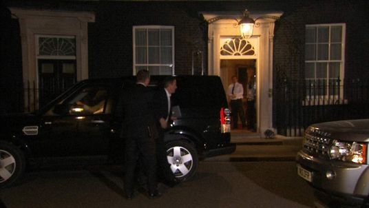 David Cameron returns to Downing Street