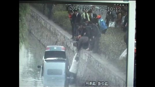 Woman rescued after car plunges into river in China