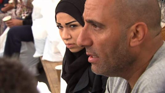 Syrian Housam Kbieh and wife at refugee centre in Munich