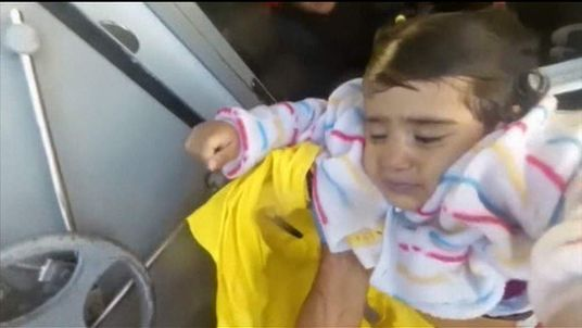 A child is among those rescued from the Aegean Sea by the Greek coastguard