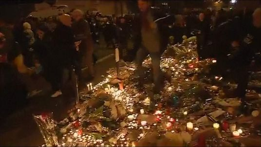 People panic after hearing screams near the Place de Republique in Paris
