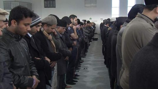 A group of UK Muslims praying